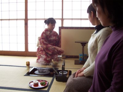 Mika performing the tea ceremony, while Yuko and Ryoko look on.